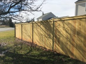 Pressure Treated Solid Board Privacy Fence with Fascia Trim