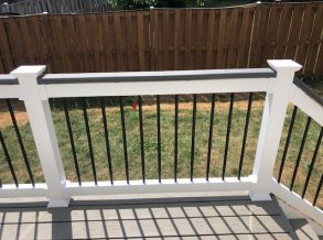 White Vinyl Rail with Black Aluminum Balusters and Trex Cap